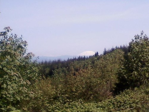Thats Mt. St. Helens, and if the camera on my phone was better, youd be able to see Mt. Ranier poking up to the left.