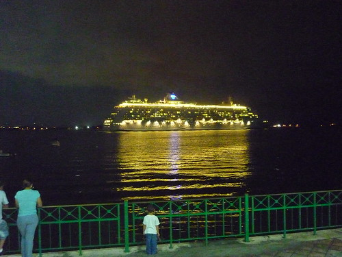 A cruise ship leaving San Juan at night
