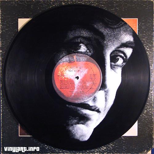 Paul McCartney pintado sobre disco de vinil