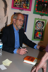 Elmore Leonard signs a copy of his new book, R...