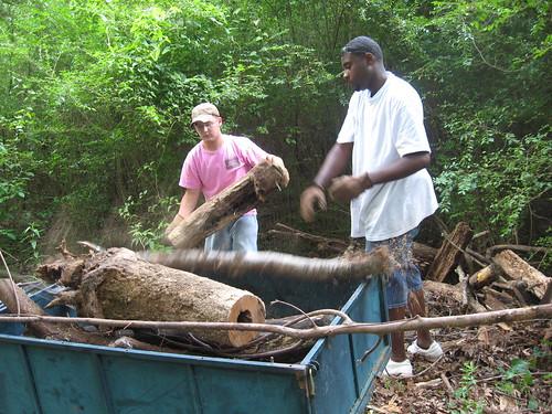 Kyle and Eddie clean up brush and debris.