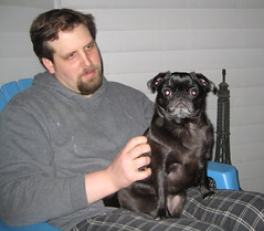 Zoe on her Daddy's lap on the back porch.