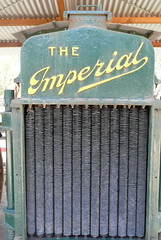 "Radiator grille of an old steam engine, with the words ""The Imperial"" on it."