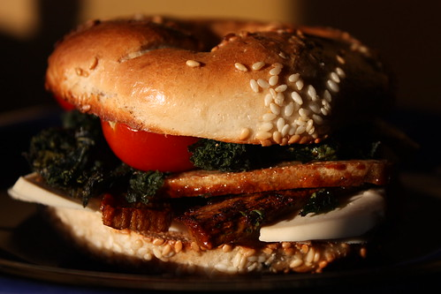 Bakn, kale, and tomato bagel
