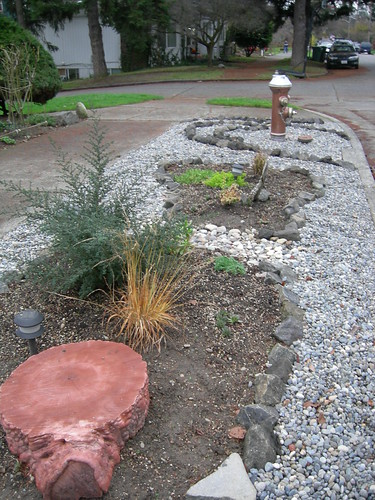 Parking strip rock garden beds