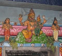 Thayar with the Lion face - Sudai sculpture above the sanctum sanctorum (by Raju's Temple Visits)