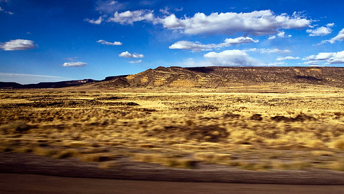Another out-of-the-car-window shot. Im pretty sure this is still New Mexico, since the sun is still shining. The sun was setting dramatically when we entered Arizona.
