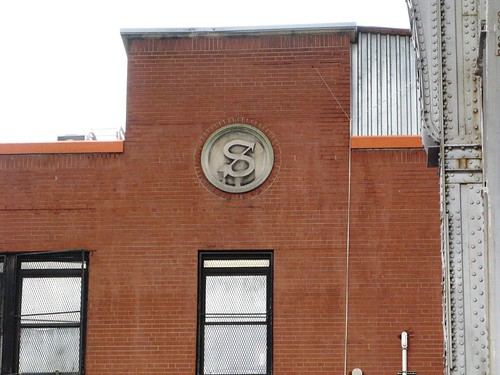 This is the building that Fairway Uptown is in. Does anyone know what the symbol is?