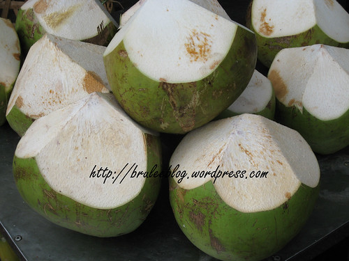 These green coconuts had their top sliced off and you could drink the water. Was also given a spoon to eat the young coconut meat.