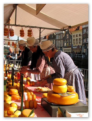 Cheese stalls at Alkmaar Cheese Market by you.