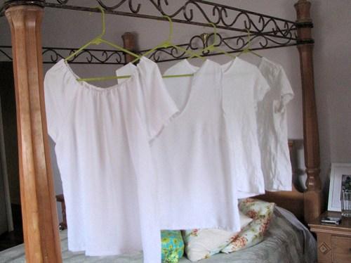 Four white shirts