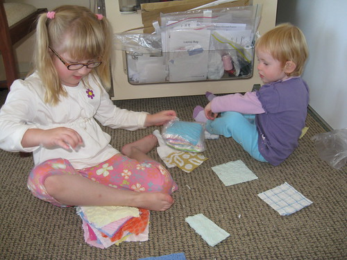 The girls sorting out the craft squares by you.