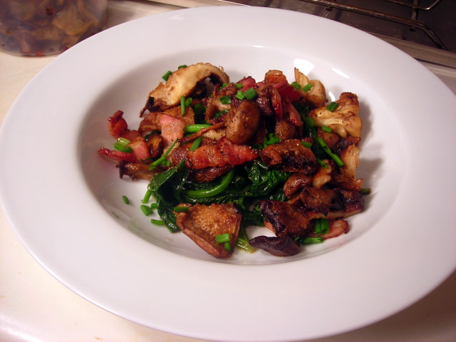 Smoked bacon and wild mushoorms over sautéed spinach