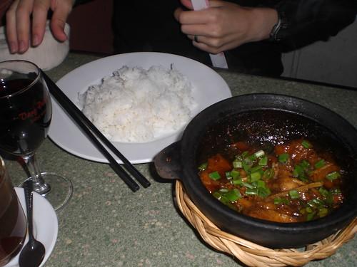 Clay pot fish and Dalat red wine at Lotus Cafe