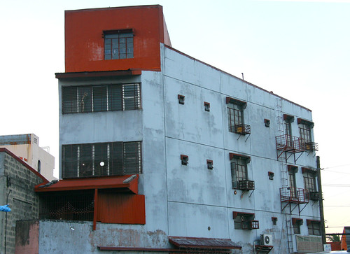 gray and red building