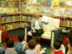 Debbie reading to children during Lapsit Story...
