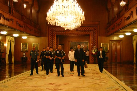 Secretary of National Defense Gilbert Teodora and PNP Chief General Jesus Versoza entering the Rizal Hall through the Gallery of Presidents.