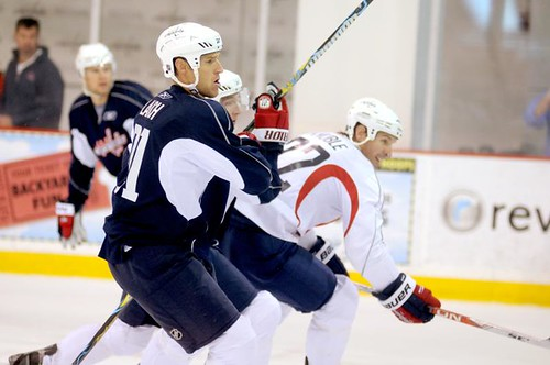 Mike Knuble and Brooks Laich battle for a puck