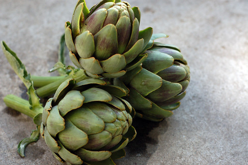 Weve eaten five artichokes so far this summer, and there are two more on the plant.  Artichokes are pretty much my favorite food ever.