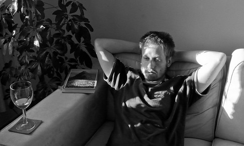 Monochrome photo of me, relaxing on the sofa after a walk