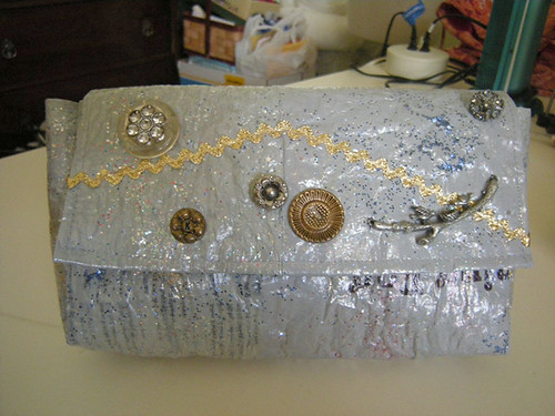 Ok, this wasnt really in the running for the fair, I made it about a month ago because I wanted a new clutch to match a new dress. Its made with gray plastic bags and embellished with vintage buttons and rickrack. Also, glitter.