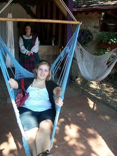 In a hammock chair in Ann's booth