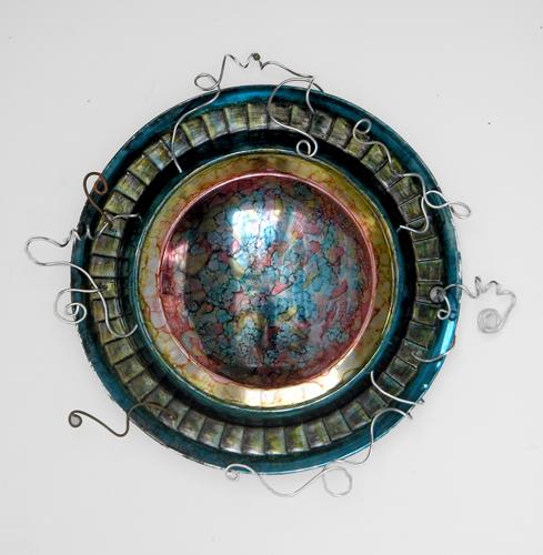 hubcap art, work in progress (c) 2009 Lynne Medsker