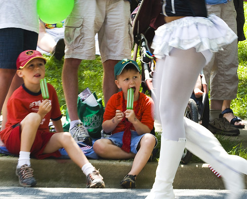 Six-year-old Joel Simpson and four-year-old Alex Simpson watch members of the Baltimore City Entertainers pass during Takoma Parks 120th annual Independence Day parade on July 4, 2009.
