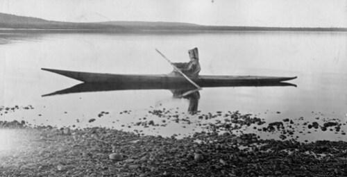 Mrs. Cotter kayaking on the North West River, Hamilton Inlet, Labrador, NL, 1909