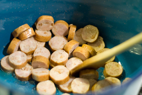 browning the chicken-apple sausages (by bookgrl)