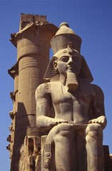 Statue of Ramses II at the entrance to the Luxor Temple in Egypt