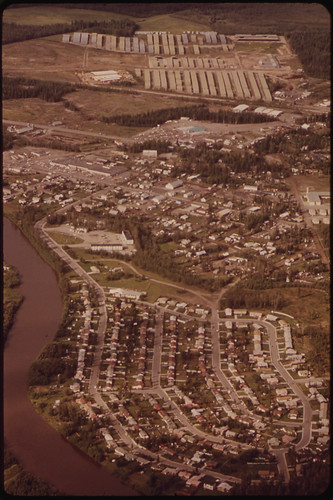 Island Homes Subdivision and the Fairbanks Pipe Yard, the Storage Point for More Than 200 Miles of 48-Inch Pipe. View North near Mile 445 08/1973