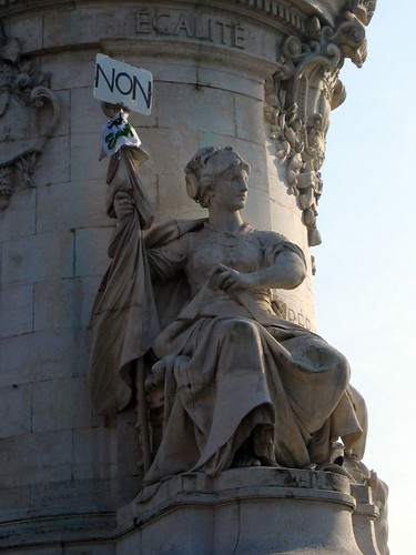 NON!!! says the statue at Place de la Republique. Probably leftover from the January 29 strike.