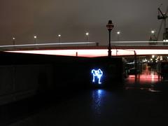 Two light flowers growing next to London Bridge
