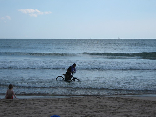 This guy kept biking back and forth along the shore, at least a few feet in the water. Every minute or two, he would sink, knee deep, laugh to himself, and proceed.