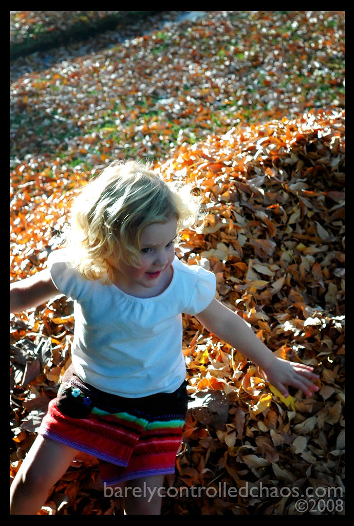 Playing in the leaf mountain