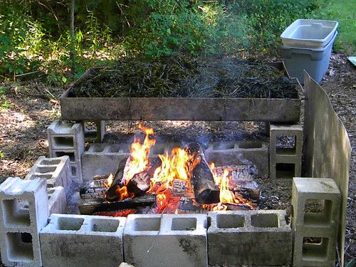 Check out this great set up- all of the prep work is done with the pan off the direct heat- once done you move it over the heat to begin cooking- this avoids some layers cooking too fast.