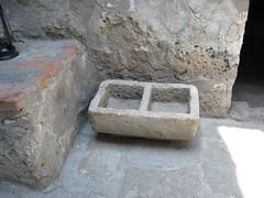 Carved sillar stone basin