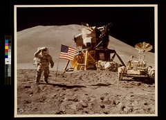 Astronaut James Irwin gives salute beside U.S....