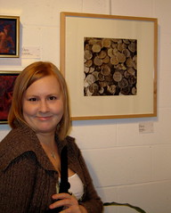 Sara with her photo at the gallery