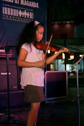 Veda playing the violin