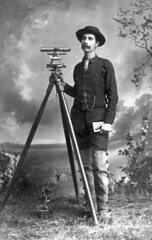 Overton Bernard with surveying equipment