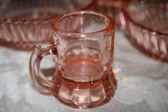 Two inch tall pink glass beer mug