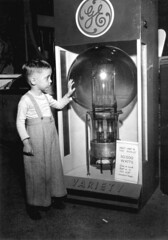 Tommy Dodgen, age 4, standing by the largest lamp in the world: Tampa, Florida