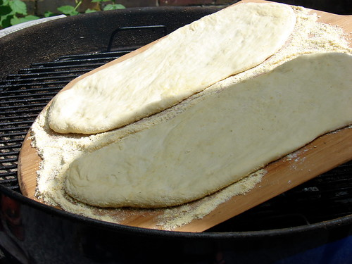 sliding the crusts onto the grill