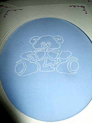 Closeup of the central teddybear design outlined with pinpricks