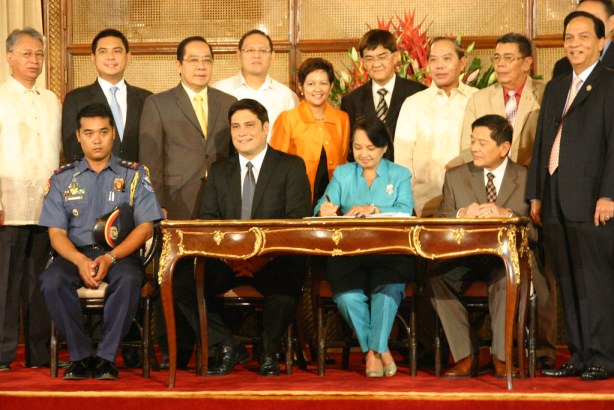Pres. Arroyo signs RA 9708 which give s policemen five more years to comply with the education requirements for police officers, among other things.
