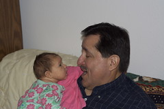 Grandpa Tony helps Elena work out a burp.
