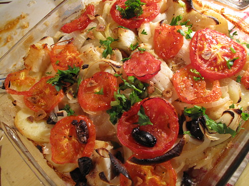Homemade bacalhau (salted codfish) with potatoes, tomatoes and olives (typical Portuguese dish)