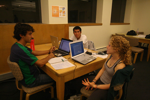 Students talk quietly in a conversation zone near the computer lab in Gleeson library. The new zones are marked with signs and indicate the level of noise permitted.  Photo by Melissa Stihl/Foghorn